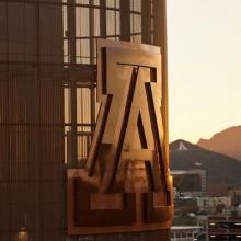The UA logo on school building