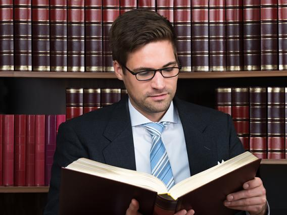 Advocate reading a book at court