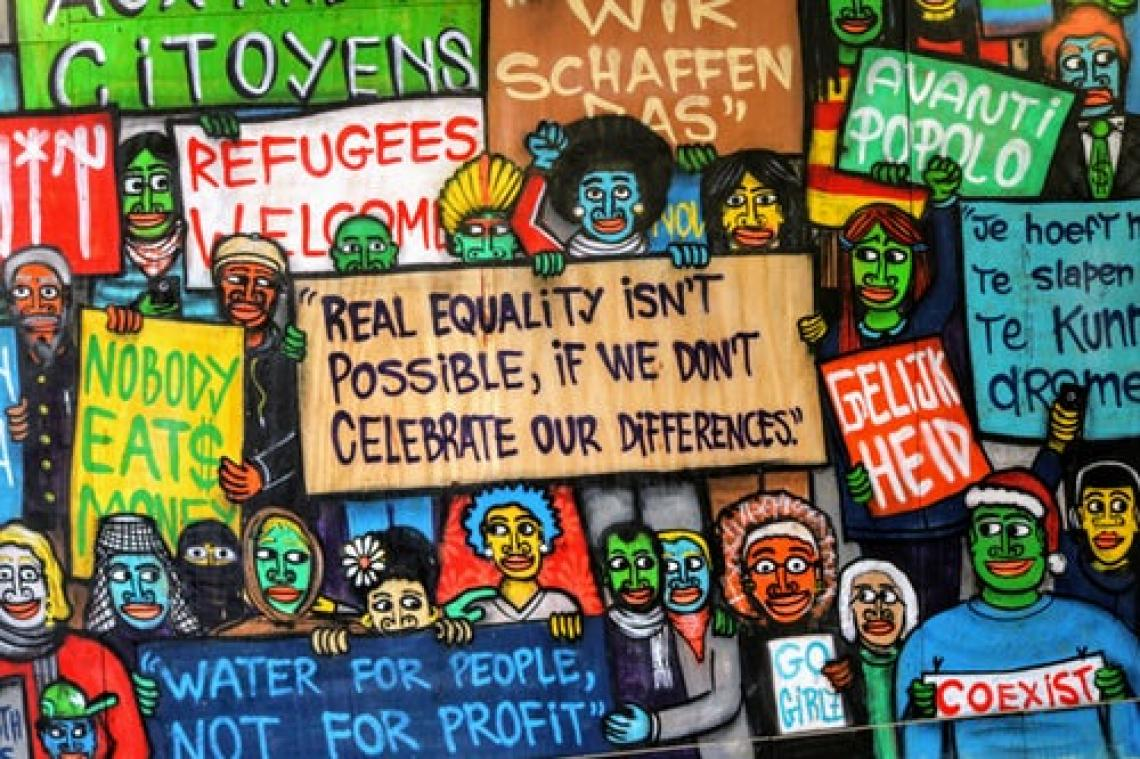 Wall art of people holding signs protesting for global citizenship and refugees